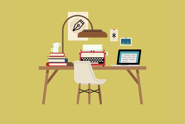 Schreibtisch mit Laptop im Büro eines Übersetzers in Berlin